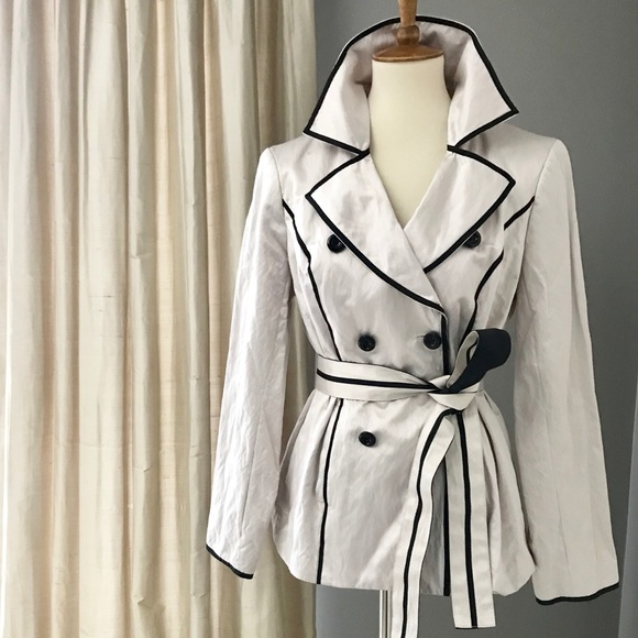 Cream trench coat w/ black piping detail